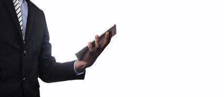 Businesssman holding tablet isolated on white background photo