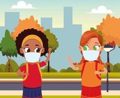 chicas interraciales usando mascarillas para covid19 en el parque vector
