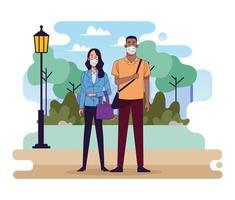 joven pareja interracial con máscaras médicas en el parque vector