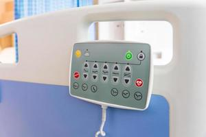 Hospital bed remote control hanging on the bed rail