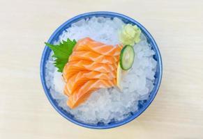 Salmon sashimi on ice serve photo
