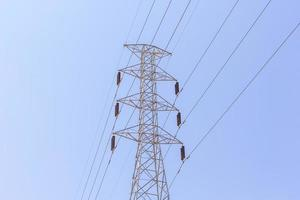 High-voltage tower on blue sky background