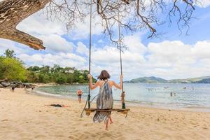 Young women on Paradise beach in Phuket, Thailand