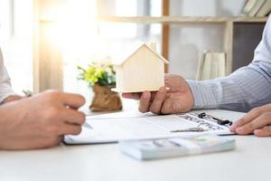 Person signing a housing contract photo