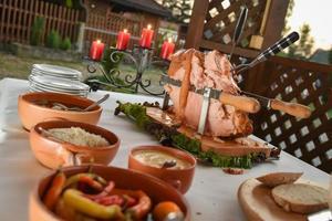 Pork leg with sauces for a banquet