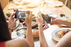 Photographing a dinner party with friends photo