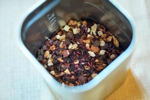 Dried tea leaves in metal bowl photo
