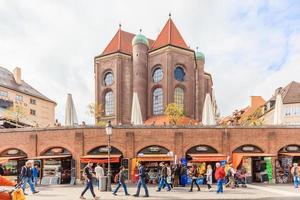 Pedestrians at the Viktualienmarkt in Munich, Germany, 2016 photo