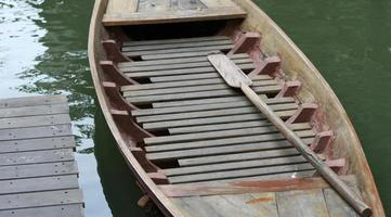 Floating wooden boat
