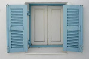 Window with blue shutters photo