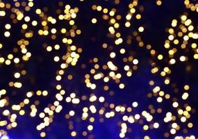 Gold bokeh lights on a blue background photo