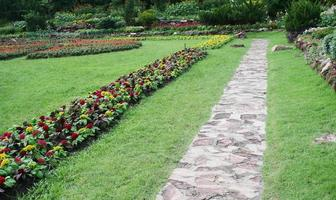 Walking path in a flower garden photo
