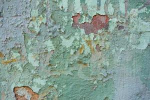 Textura de una pared vieja con pintura desconchada foto