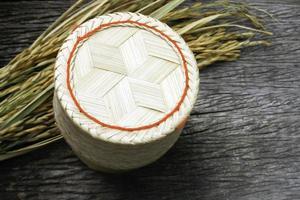 Bamboo rice box on wood