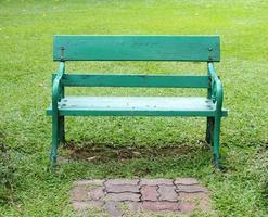 Empty green bench photo