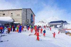 Skiers in the Swiss alps in Murren, Switzerland