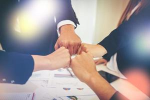 Business people showing fist bump after meeting photo