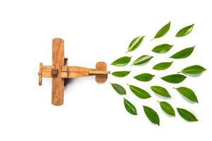 Wooden plane and leaves on white background photo