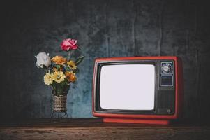 Old retro TV still life with flower vases
