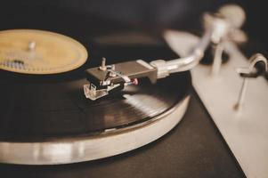 Spinning record player with vintage vinyl photo