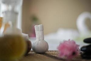 Bottle of essential oil and spa treatments photo
