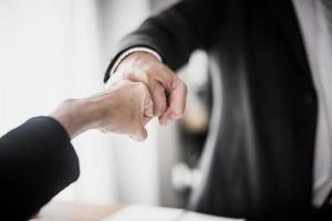 Business people showing fist bump photo