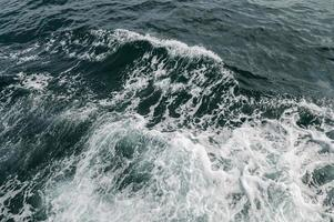 Ocean waves caused by boats photo