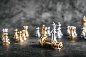 Gold and silver chess board game photo