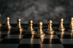 Gold chess board game photo