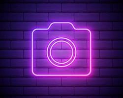 Neon photo camera sign. Photostudio neon banner. Luminous signboard camera, night advertisement neon cam. Pink neon light on dark purple background. Vector illustration EPS10