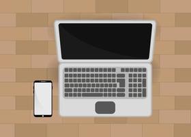 maqueta de laptop y smartphone vector