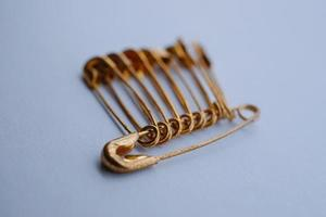 Gold safety pins photo