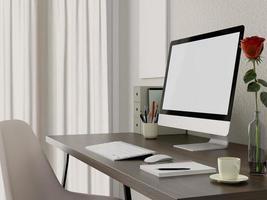 Mock up computer on desk top photo