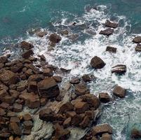 Waves hitting rocks on the coast in Bilbao, Spain photo