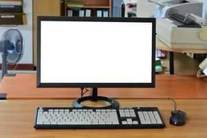 Old computer desktop with blank screen in office room photo