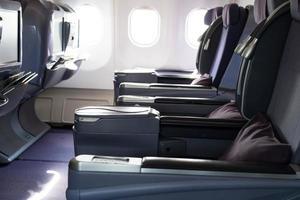 Passenger seats in plane photo