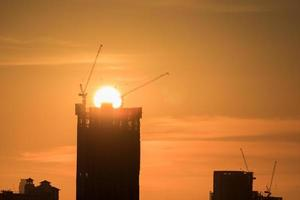 Silhouettes of buildings at sunset photo