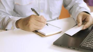 Person taking notes at a desk