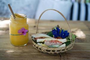 Sandwich in a basket with a drink photo