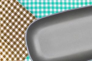 Round rectangular plate on cloth photo