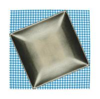Square plate on blue cloth