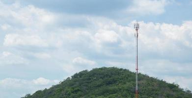 Telecommunications tower in the forest photo