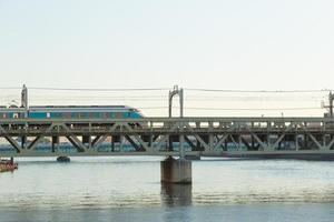 Train on the bridge in Tokyo photo