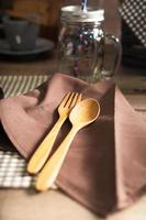 Wooden spoon and fork on the napkin