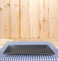 Black plate on blue cloth