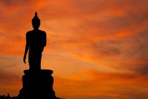 Buddha statue at sunset in Thailand