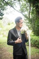 Beautiful bouquet in the hands of the groom for bride photo