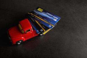 Credit cards on a small model red pickup truck photo