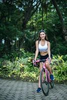 Woman riding a pink bike photo
