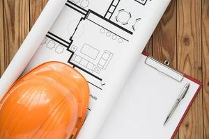 Top view of engineer plan on wood background photo